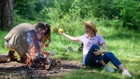 Woman straw hat sit meadow hold apple fruit. Healthy life is her choice. Girl enjoy picnic with healthy snack apple royalty free stock images