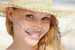 Woman in straw hat smiling at camera Stock Photos
