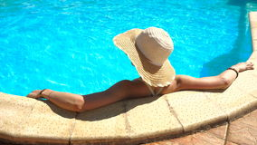 Woman in straw hat sunbathing and swimming stock footage