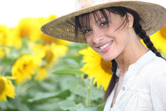 Woman in a straw hat Stock Image