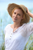 Woman with Straw Hat Royalty Free Stock Photography