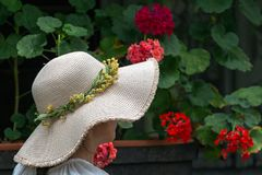 Woman with straw hat Stock Photography