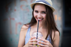 Woman in straw hat Stock Images