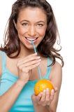 Woman with straw and orange Royalty Free Stock Photos