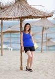 Woman with straw parasol Stock Photos