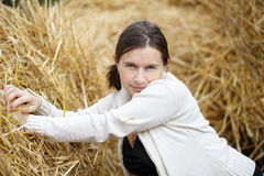 Woman and straw Royalty Free Stock Photography