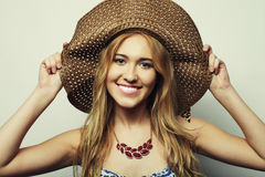 Woman in  straw summer hat Royalty Free Stock Image