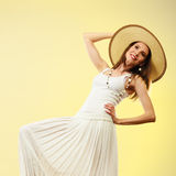 Woman in straw summer hat white dress Stock Photography