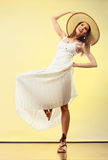 Woman in straw summer hat white dress Royalty Free Stock Image