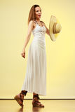 Woman in straw summer hat white dress Stock Photo