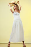 Woman in straw summer hat white dress Stock Image