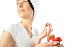 Woman with strawberries Stock Image