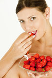 Woman with strawberries Royalty Free Stock Image