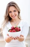 Woman with strawberries Royalty Free Stock Photography