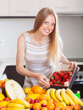 Woman with  strawberries and other fruits Royalty Free Stock Photography