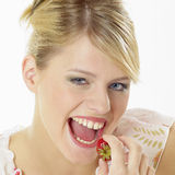 Woman with a strawberry Stock Images