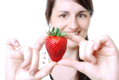 Woman with a strawberry Royalty Free Stock Photography