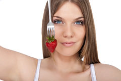 Woman and strawberry Stock Photos