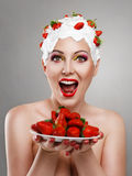 Woman with strawberry Royalty Free Stock Images