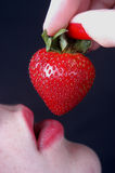 Woman and Strawberry. Woman preparing to eat a strawberry Royalty Free Stock Photography