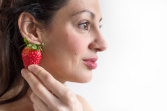 Woman and strawberry. Stock Photo