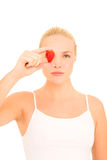 Woman with a strawberry on eye Stock Image