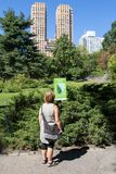 Strawberry Fields Central Park New York. Woman at Strawberry Fields in Central Park, Manhattan, New York, USA. September 24, 2015 royalty free stock photography