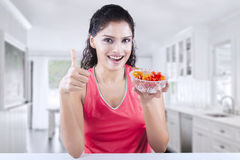 Woman with strawberry giving OK sign Royalty Free Stock Images