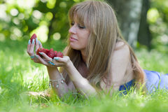 The woman and a strawberry handful Royalty Free Stock Image