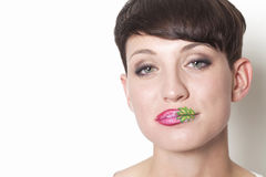 Woman with strawberry lips smiling Royalty Free Stock Images