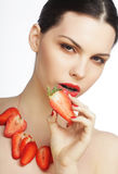 Woman with strawberry on the white background Stock Photography