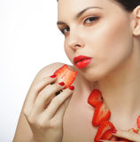Woman with strawberry on the white background Royalty Free Stock Photo