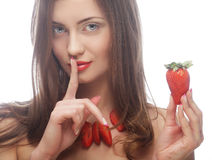 Woman with strawberry on the white background Royalty Free Stock Photography