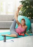 Woman streching her leg Royalty Free Stock Photos