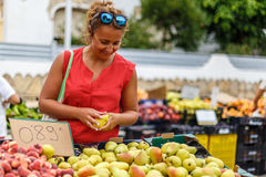 Woman on street fruit market in SPain. Woman on summer street fruit market in SPain royalty free stock images