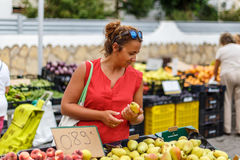 Woman on street fruit market in SPain Royalty Free Stock Image