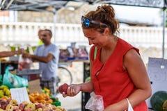 Woman on street fruit market in SPain. Woman on summer street fruit market in SPain stock photo