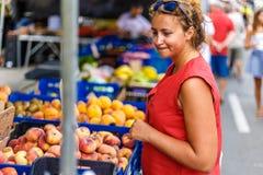 Woman on street fruit market in SPain. Woman on summer street fruit market in SPain stock images
