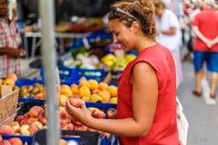 Woman on street fruit market in SPain. Woman on summer street fruit market in SPain stock photography