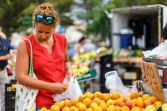 Woman on street fruit market in SPain. Woman on summer street fruit market in SPain royalty free stock photo