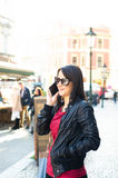 Woman on a street make a call. Happy woman in a Prague. On a street Stock Images
