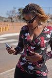 Woman street phone Stock Photography