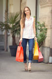 Woman on street with shopping bags Stock Photo