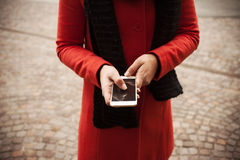 Woman in the street using her mobile Stock Images