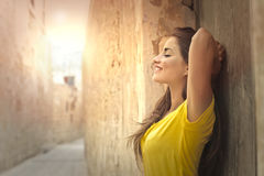 Woman on the street. In yellow T-shirt Royalty Free Stock Image
