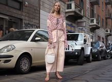 MILAN, Italy: 19 september 2018: Woman streetstyle outfit after BYBLOS fashion show. Woman streetstyle outfit after BYBLOS fashion show during Milan fashion week stock photo
