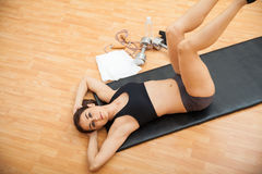 Woman strenghtening her abs at the gym Stock Image