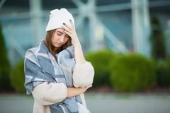 Woman stress. Beautiful sad desperate woman in winter coat suffering depression royalty free stock image