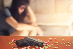 Woman stress and depressed of her sickness, she decided to kill herself with a gun Stock Photo