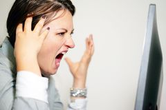Woman in stress in front of computer stock image